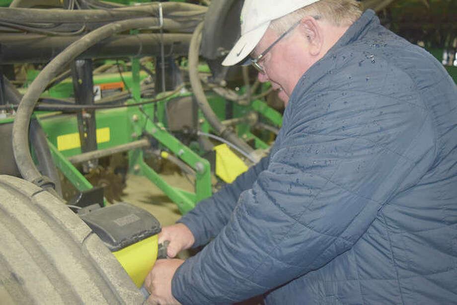 Jon Freeman checks his equipment in preparation for planting. Photo: Samantha McDaniel-Ogletree | Journal-Courier