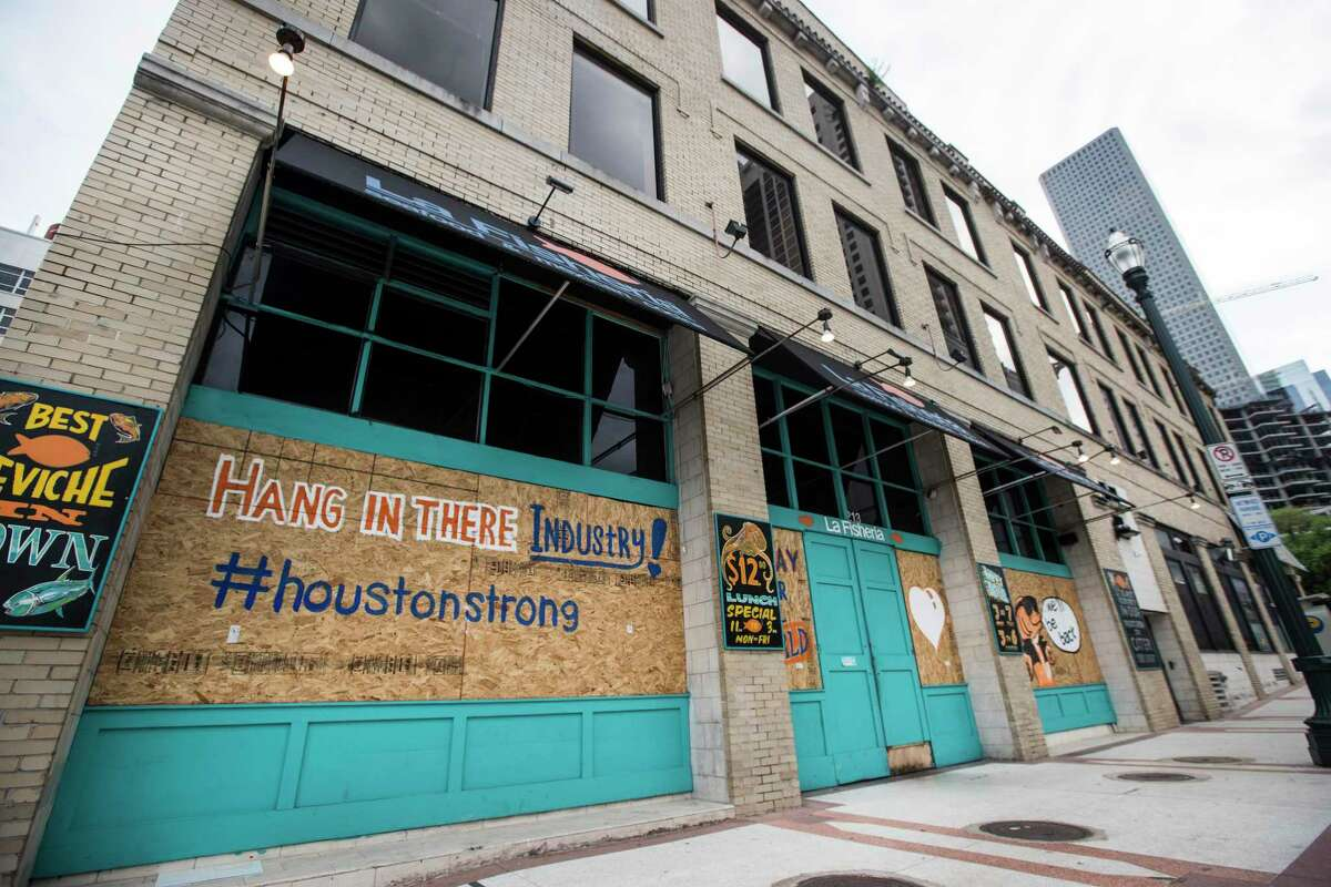 La Fisheria on Milam downtown is boarded up on Saturday, March 28, 2020 in Houston. Businesses around the city have been closed and boarded up due to the coronavirus pandemic precautions, forcing several businesses to shut their doors.