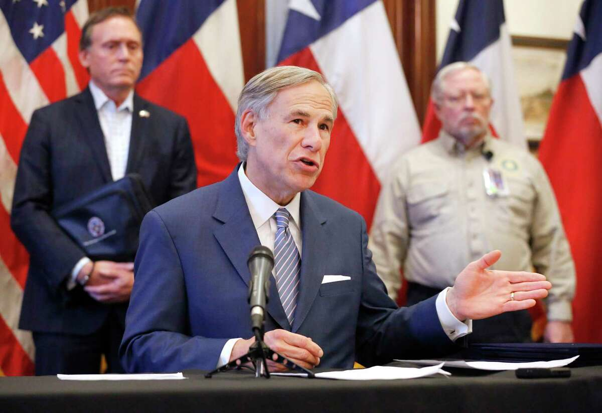 Texas Governor Greg Abbott announced the US Army Corps of Engineers and the state are putting up a 250-bed field hospital at the Kay Bailey Hutchison Convention Center in downtown Dallas during a press conference at the Texas State Capitol in Austin, Sunday, March 29, 2020. The space can expand to nearly 1,400 beds. Joining him was former State Representative Dr. John Zerwas (left) and Texas Department of State Health Services Commissioner John Hellerstedt, MD. (Tom Fox/The Dallas Morning News/Pool)