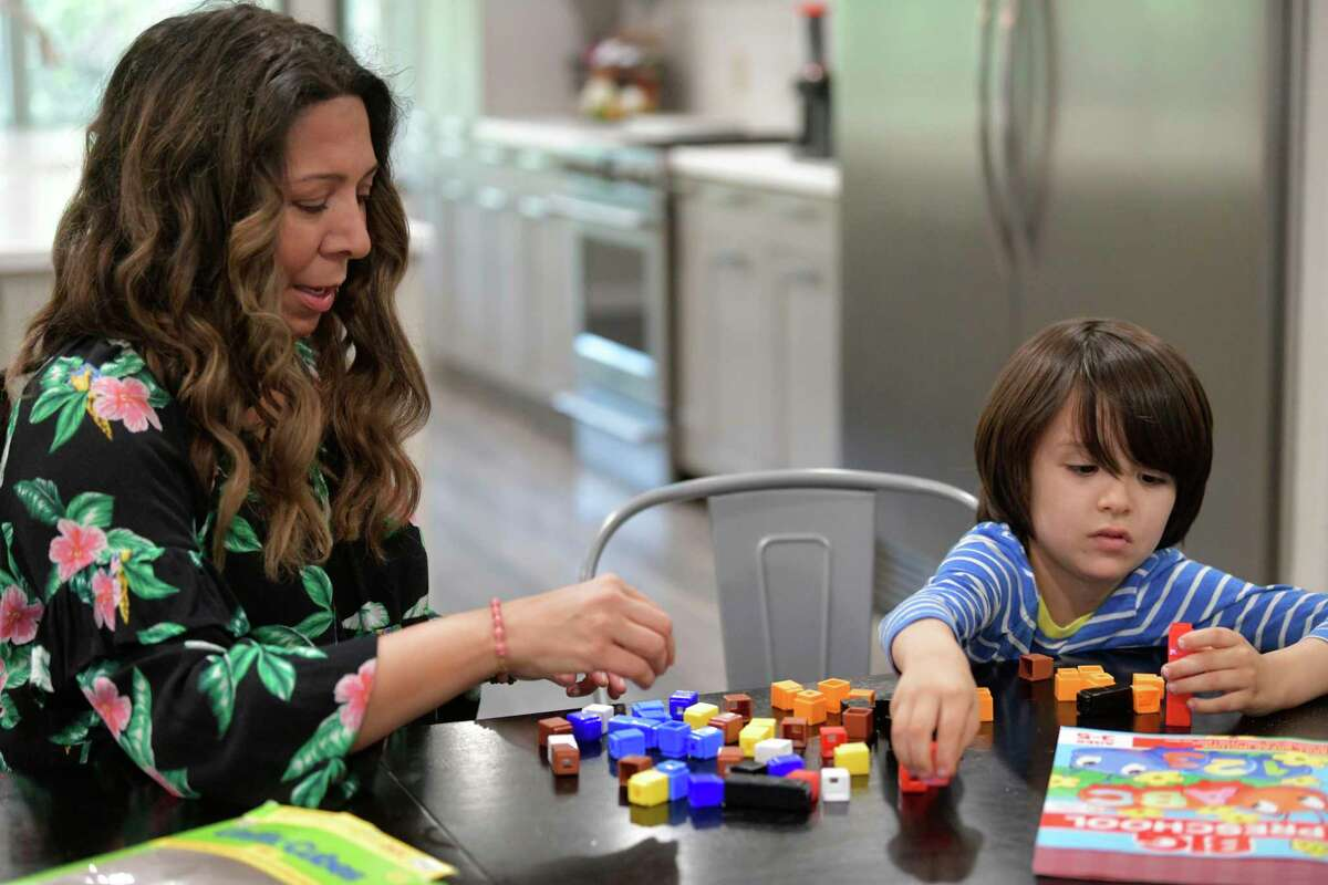 Ruth Funk has been homeschooling her three children for five years. She works with her son, Luke, 5.