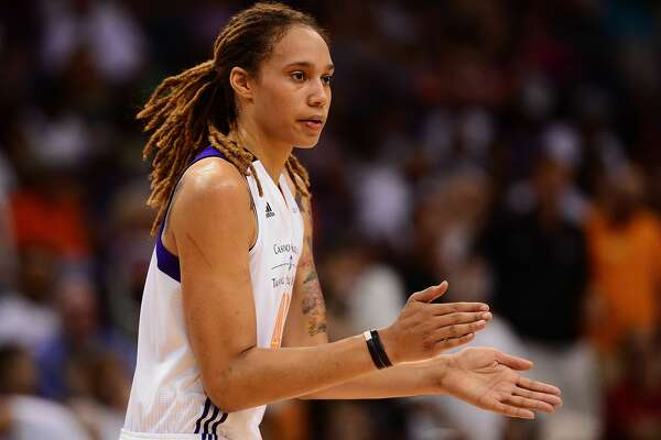 PHOENIX, AZ - SEPTEMBER 07: Center Brittney Griner #42 of the Phoenix Mercury claps on the court in the first half against the Chicago Sky during game one of the WNBA Finals at US Airways Center on September 7, 2014 in Phoenix, Arizona. NOTE TO USER: User expressly acknowledges and agrees that, by downloading and or using this photograph, User is consenting to the terms and conditions of the Getty Images License Agreement. (Photo by Jennifer Stewart/Getty Images)