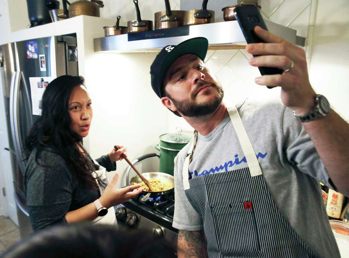 Susan Kaars-Sypesteyn, left, and her husband, Pieter Sypesteyn, shown cooking at home earlier this year, are opening a new Cambodian curbside and delivery restaurant called Golden Wat Noodle House.