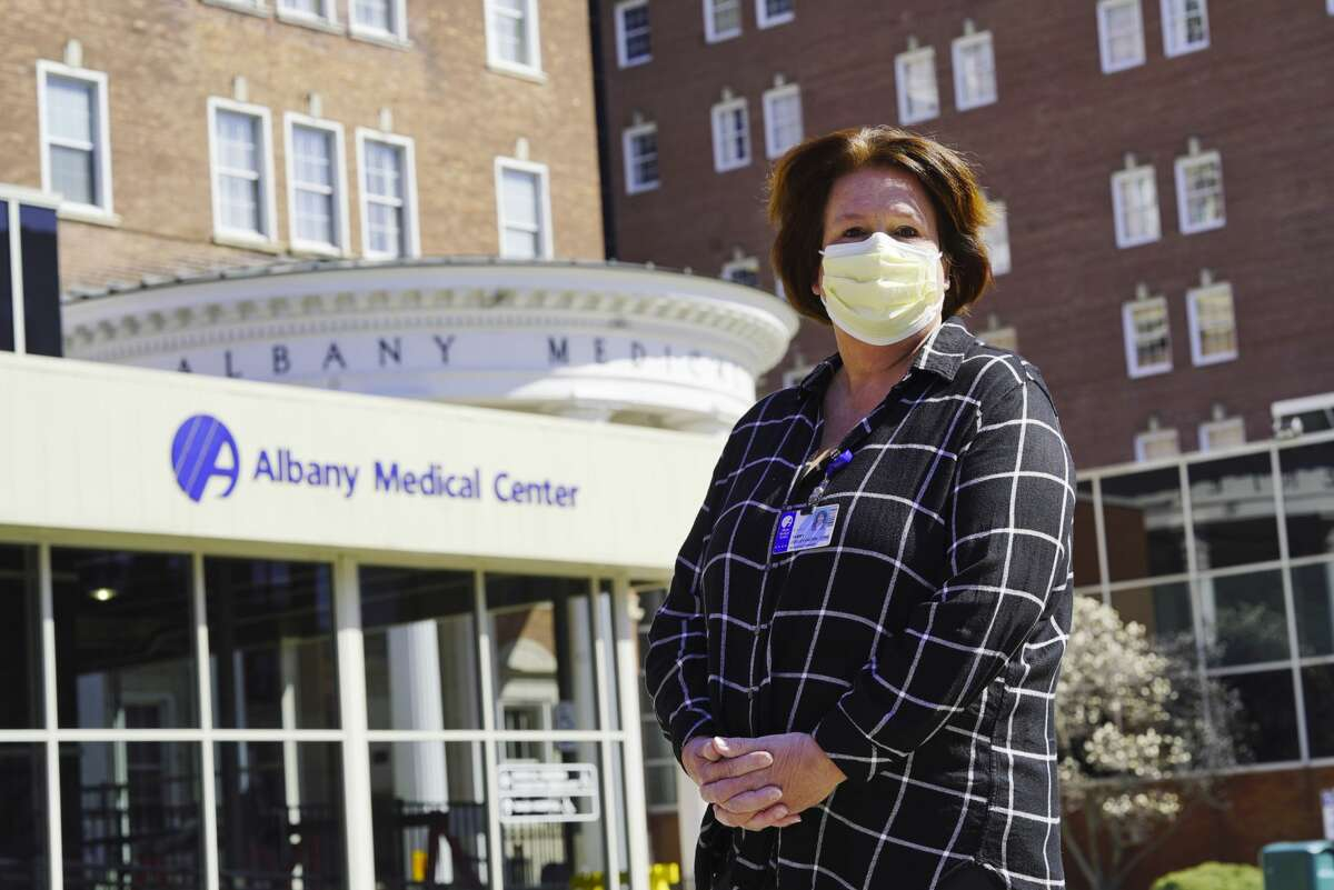 Tammy Ogden, senior recreation therapist, department of psychiatry, Albany Medical Center, stands outside of the hospital in Albany, NY, on Wednesday, April 1, 2020.