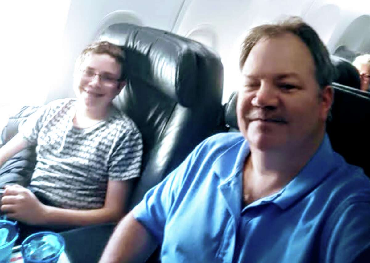 Frequent flyer Bob Morrissette onboard with his son Benjamin.