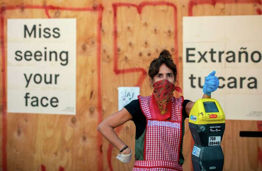 Restaurant owner Lorena Zeruche looks on wearing a bandana on her face as she prepares for take-out only in San Francisco, California on April, 1, 2020, during the novel coronavirus outbreak. Photo: JOSH EDELSON/AFP Via Getty Images