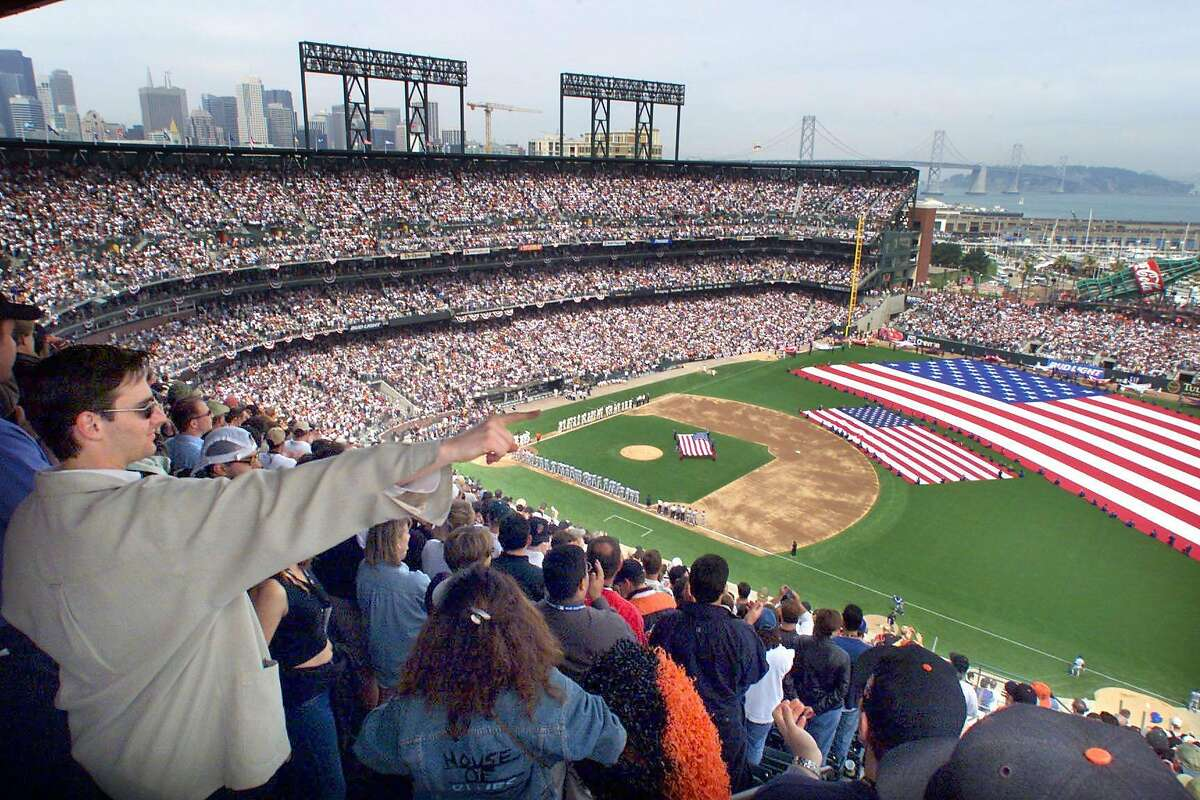 GIANTS CEREM.3-C-11APR00-MN-BW --- Giants fans watch opening day ceremonies at Pacific Bell Ballpark on Tuesday, April 11, 2000. (BRANT WARD/SAN FRANCISCO CHRONICLE)