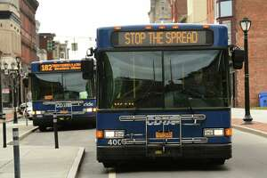 "A CDTA bus on Remsen St. displays a ""stop the spread"" message as a result of the COVID-19 pandemic on Thursday April 2, 2020 in Cohoes, N.Y.. (Lori Van Buren/Times Union)"