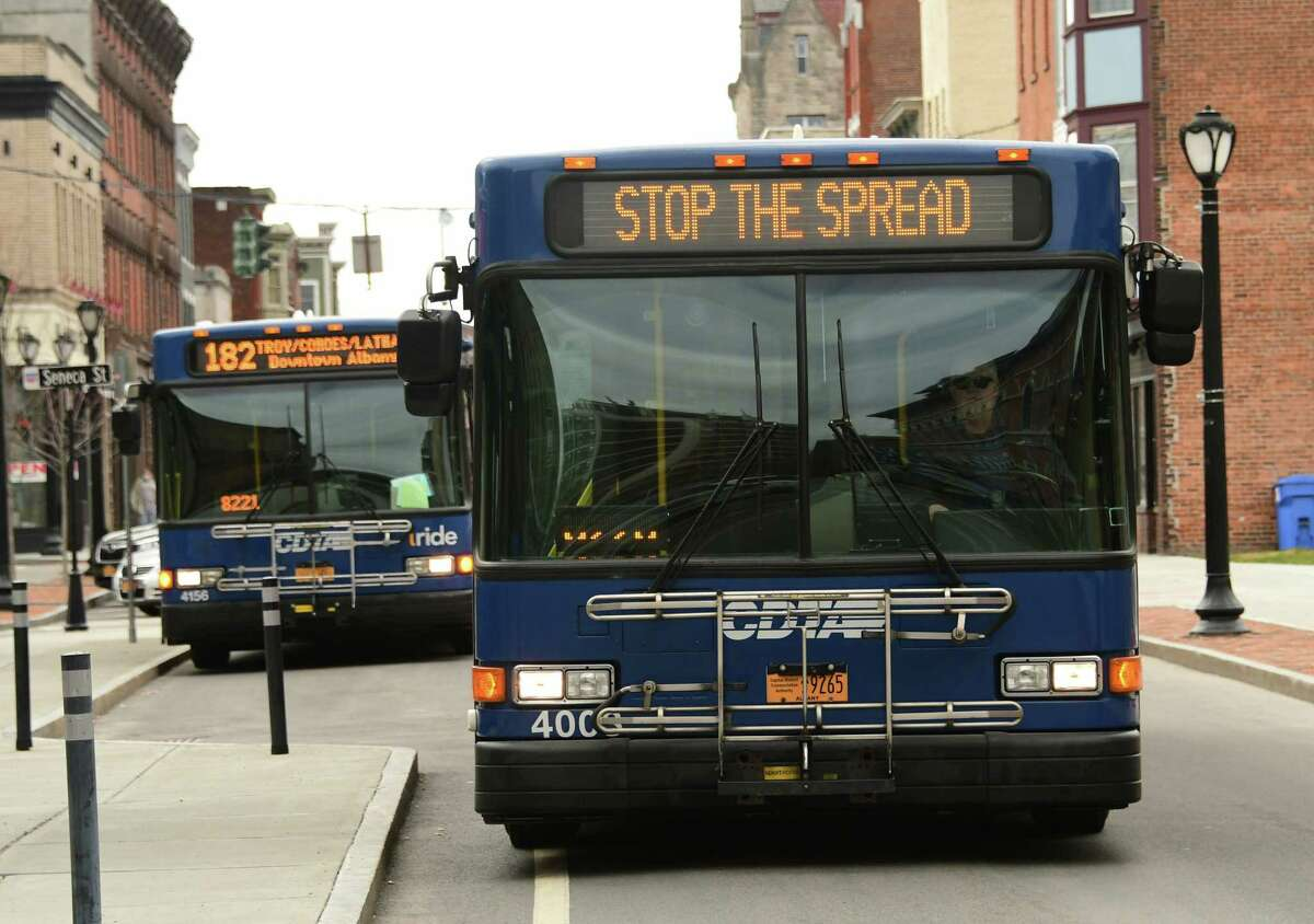 """A CDTA bus on Remsen St. displays a """"stop the spread"""" message as a result of the COVID-19 pandemic on Thursday April 2, 2020 in Cohoes, N.Y.. (Lori Van Buren/Times Union)"""