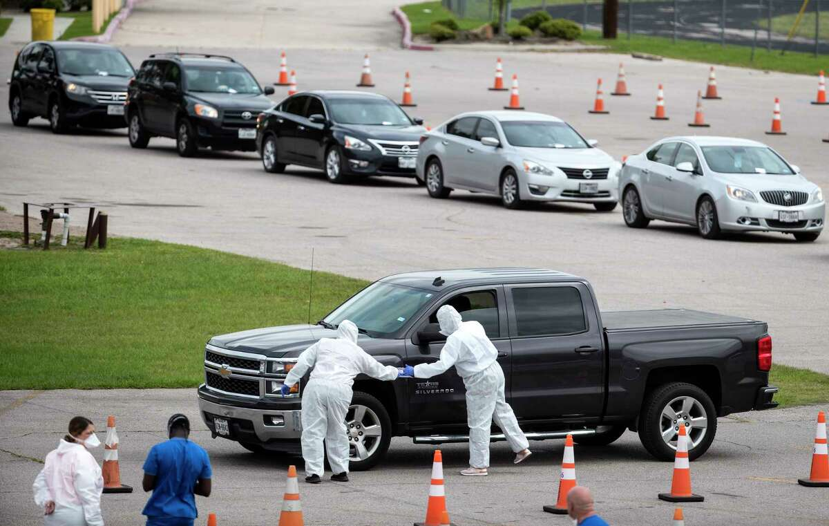 Fort Bend County Judge KP George spelled out guidelines for donating personal protection equipment in the county. Original caption: People are screened as they line up to be tested for coronavirus at a free testing site at Forest Brook Middle School set up by United Memorial Medical Center on Thursday, April 2, 2020 in Houston.