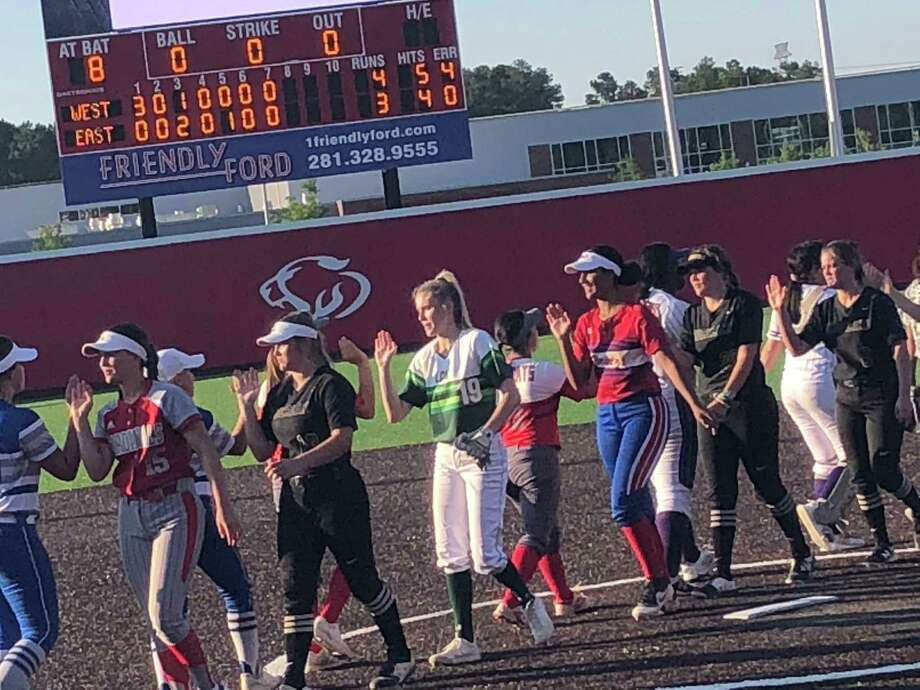 The seniors, representing 18 different schools from across Southeast Texas, shake hands following the Southeast Texas Coaches Association All-Star Classic softball game on June 13 at the Ballparks in Crosby Photo: Elliott Lapin / Staff Photo