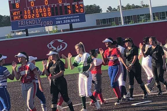 The seniors, representing 18 different schools from across Southeast Texas, shake hands following the Southeast Texas Coaches Association All-Star Classic softball game on June 13 at the Ballparks in Crosby