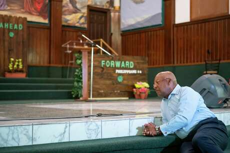 Reverend Harvey Clemons, pastor of Pleasant Hill Baptist Church, prays inside the church during a moment of silent prayer or reflection he called for across the interfaith community, Monday, March 30, 2020, at Pleasant Hill Baptist Church in Houston's Fifth Ward.