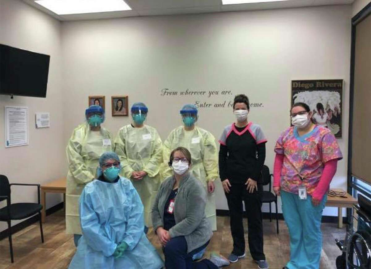 Employees from Great Lakes Bay Health prepare for COVID-19 testing. (Courtesy Photo)