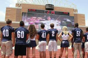 Students from Kingwood High School watch the unveiling of a new video board at George Turner Stadium for the upcoming AAU Junior Olympic Games on June 12. The 960 square foot video board is the largest at a high school facility in the United States, and will allow Humble ISD to stream game and athlete statistics, live video, instant replays and advertisements simultaneously. In addition to the new screen, Turner Stadium will also have awnings build over the stands and a new road will be built to lessen traffic in and out of the stadium.