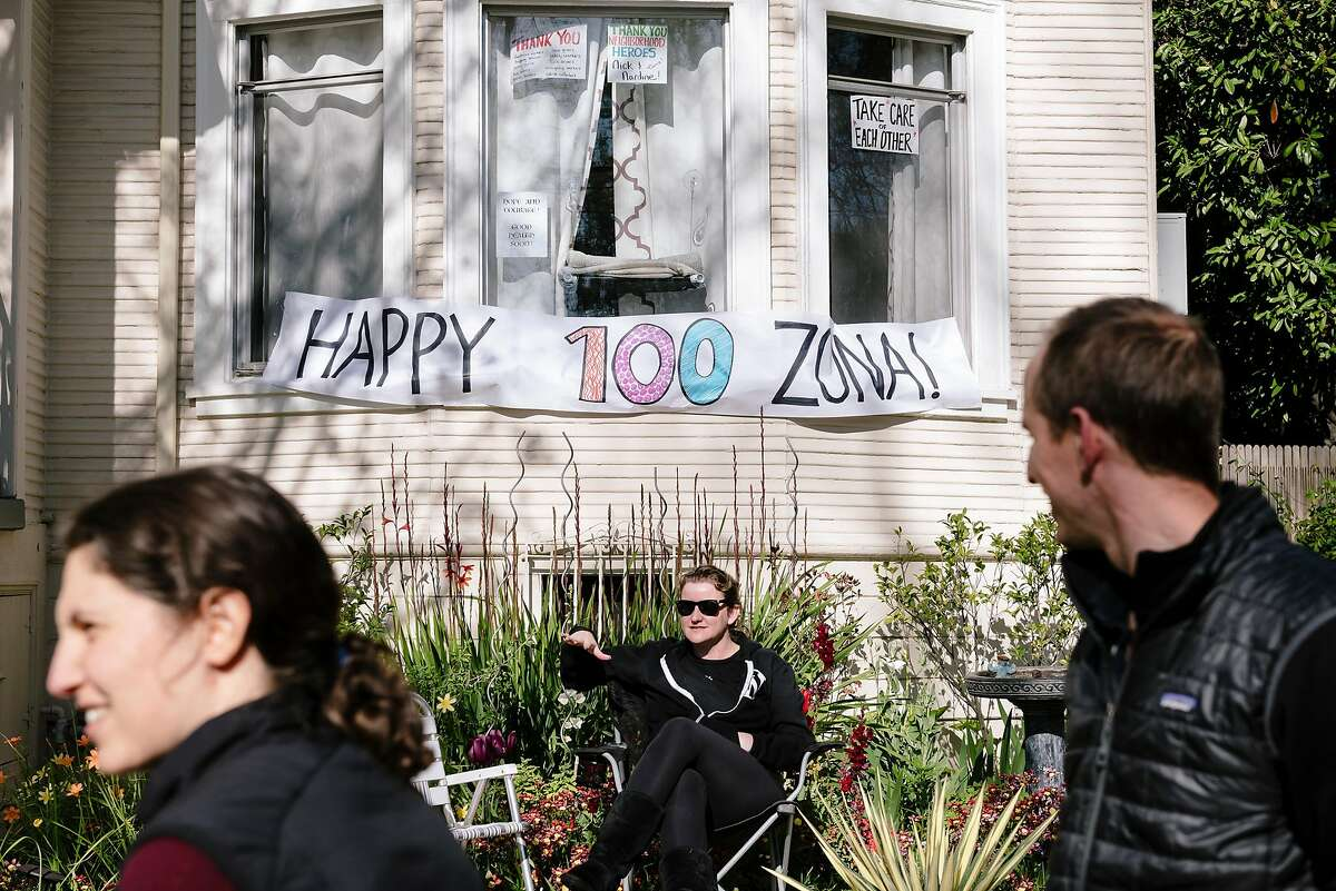 A banner hangs in the front of a home in Zona Roberts' neighborhood celebrating her 100th birthday, in Berkeley, Calif, on Wednesday, April , 2020.