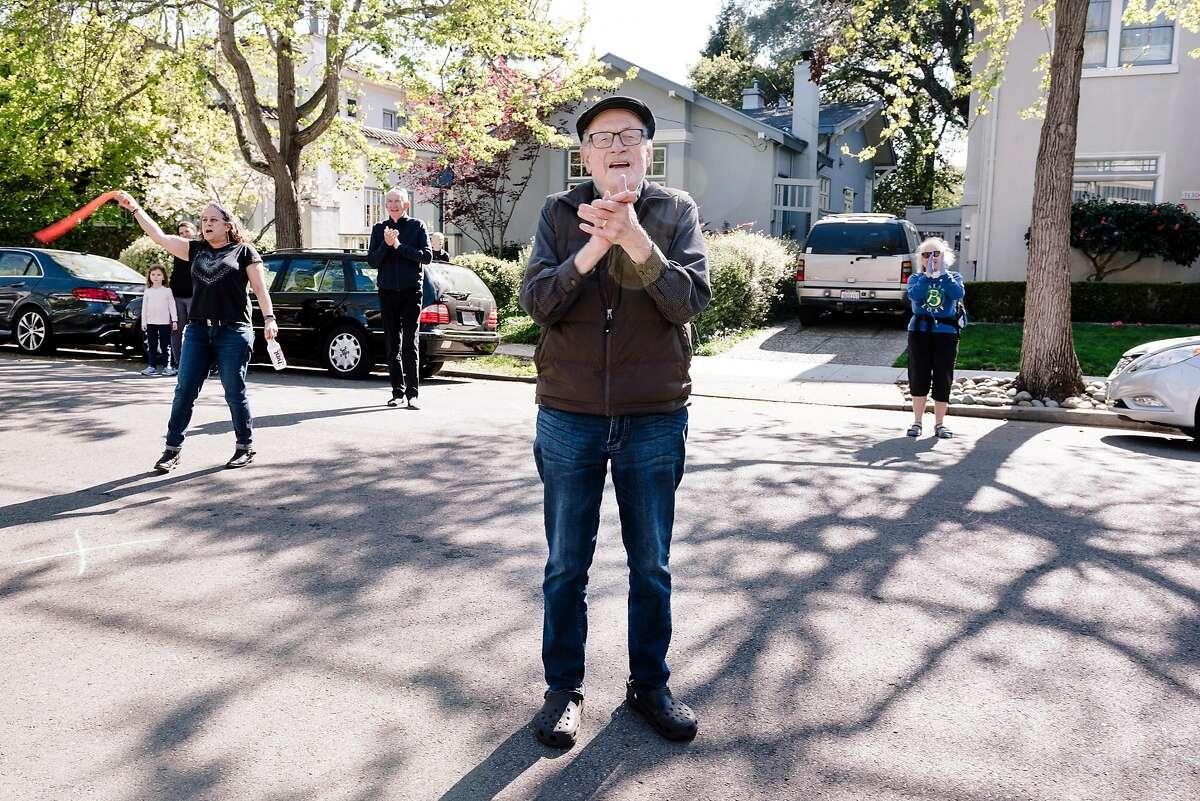 Friends and neighbors including Ramon Jimenez sing