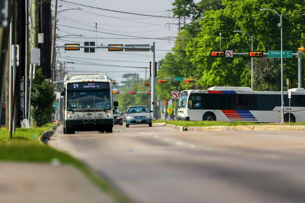 The 54 bus travels north up Scott Street on March 26, 2020, near the University of Houston.