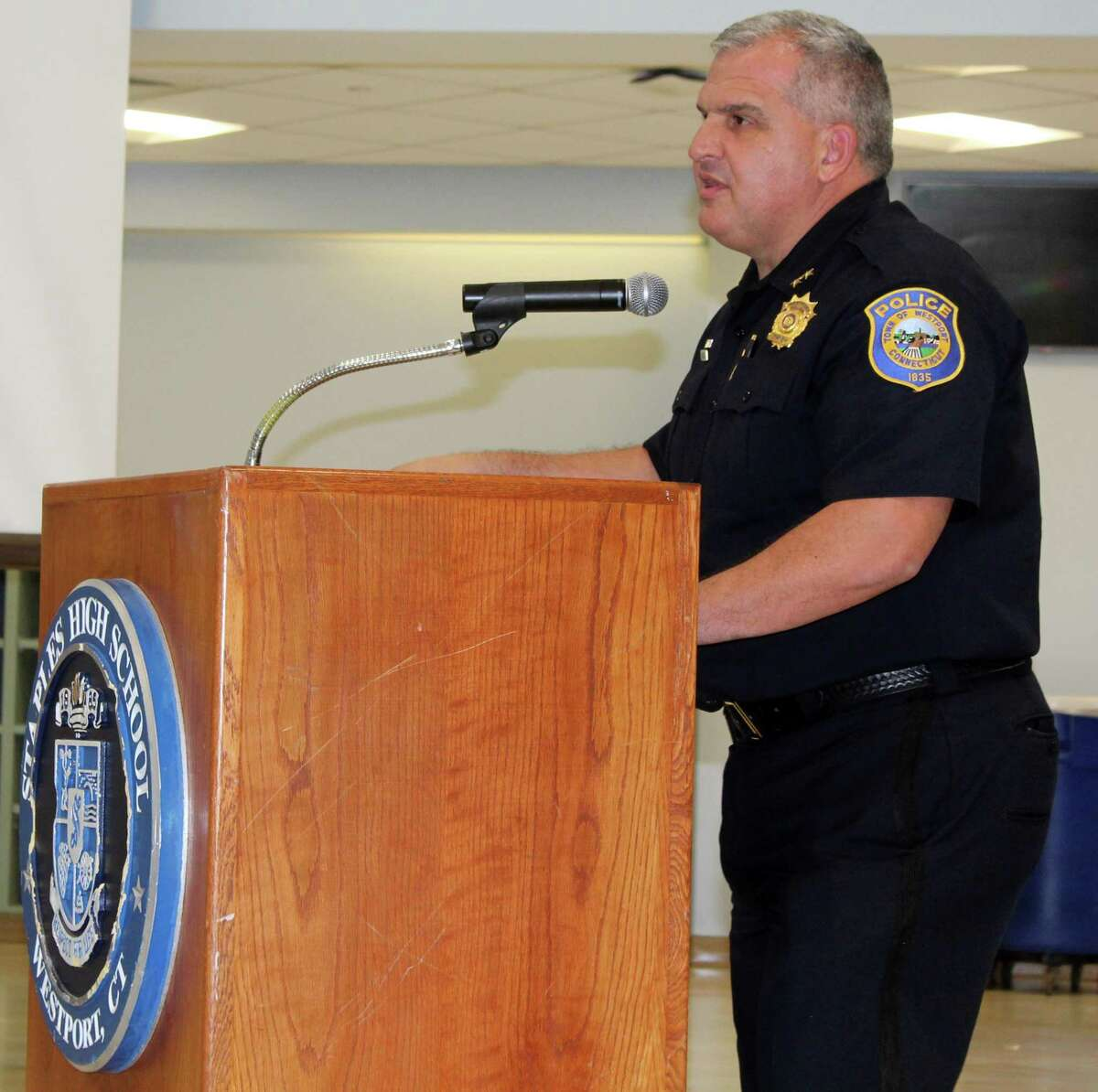 In this file photo, Westport Police Chief Foti Koskinas speaking at a Board of Education meeting at Staples High School.