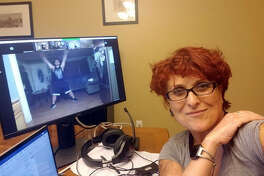Dr. Cristina De Meo, a chemistry professor at SIUE, is also one of the top instructors for Campus Recreation. She is shown conducting a Zumba class from her home. Virtual workouts have replaced on-campus workouts due to the coronavirus.