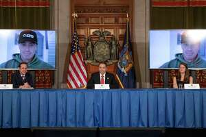 Gov. Andrew Cuomo speaks to his brother, Chris, via teleconference during a press briefing on the state's coronavirus outbreak response on Thursday, April 2, 2020, in the Red Room at the Capitol in Albany, N.Y. (Office of the Governor)