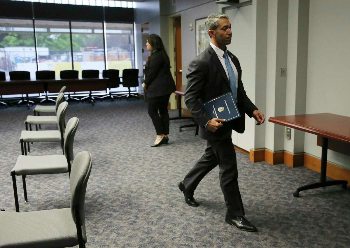 Mayor Ron Nirenberg exits a conference room on Wednesday, Mar. 18, 2020. Nirenberg said Thursday he wants to extend the city's stay-at-home order through April 30.