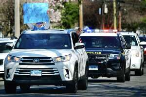 Jefferson Science Magnet School staff organized a motorcade which proceeds slowly by students' homes in Norwalk.
