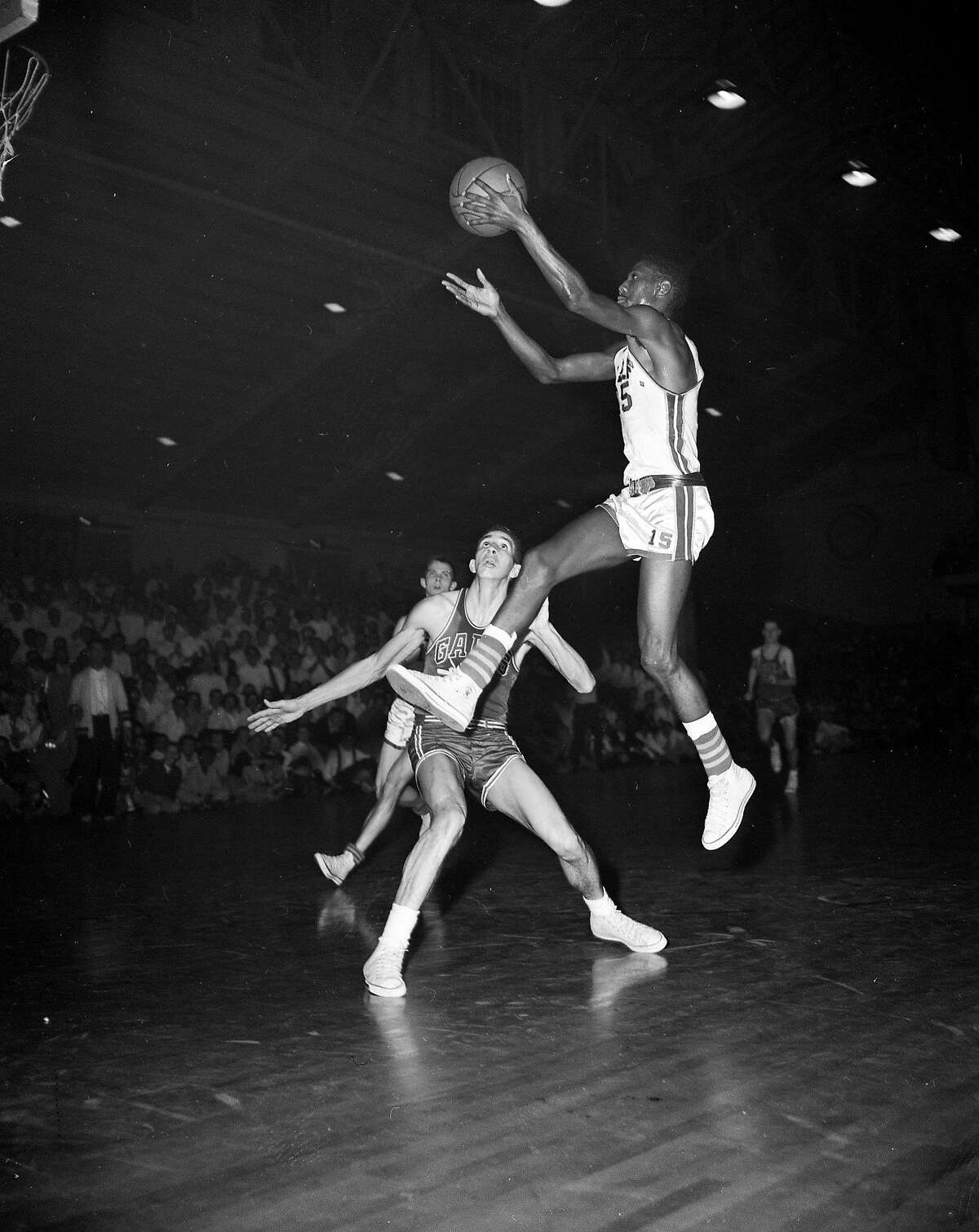 native1211 Basketball championship CBA game between USF Dons Vs St. Mary's at Kezar, March 5, 1957, USF's Eugene Brown with the ball. Dons win 62-41.