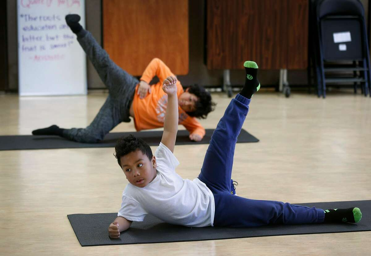 Brandon Franklin attends a yoga class during the Pop Up YKids day care program for children of first responders and medical workers at the Mission YMCA in San Francisco, Calif. on Thursday, April 2, 2020.