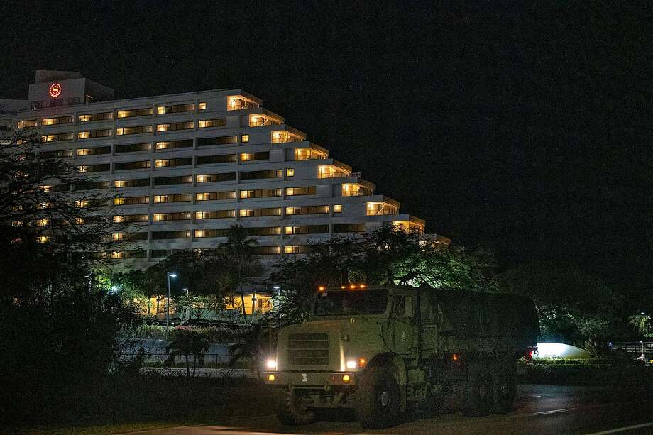 A Seabee truck departs Sheraton Laguna Guam Resort after dropping off its cargo on Thursday, April 2, 2020 . The Sheraton is one of the local hotels housing sailors from the carrier the USS Roosevelt. Photo: Anthony Henri Oftana / Special To The Chronicle