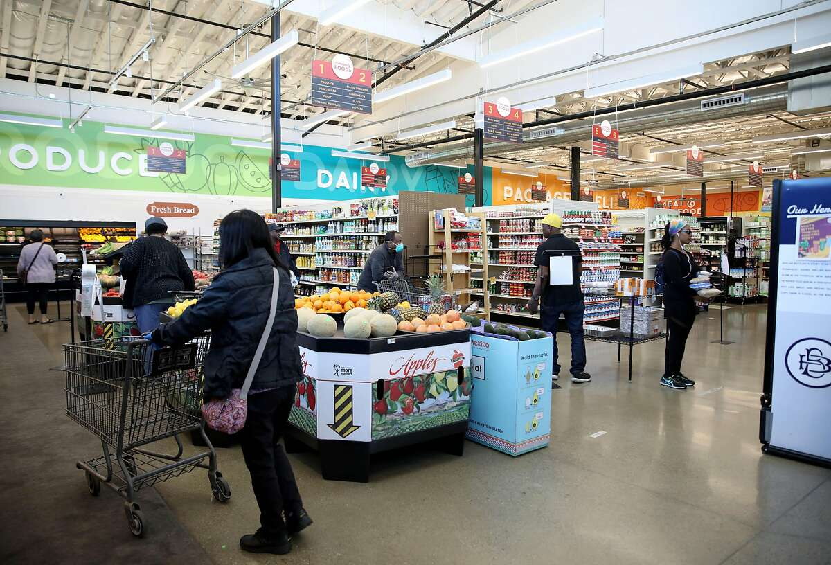 Customers shop at Community Foods Market, located at 3105 San Pablo Ave., on Thursday, April 2, 2020, in Oakland, Calif.