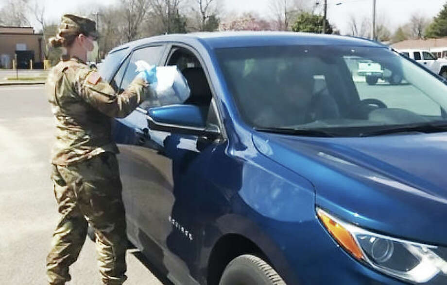 An Illinois National Guard member helps collect donated personal protection equipment at the Madison County Wood River warehouse at 101 E. Edwardsville Road, Wood River.