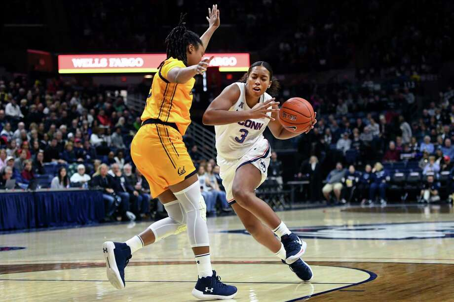 UConn's Megan Walker drives around Cal's Jaelyn Brown during a game in March. Photo: Stephen Dunn / Associated Press / Copyright 2019 The Associated Press. All rights reserved