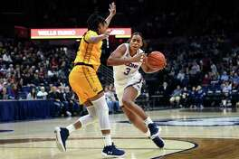 UConn's Megan Walker drives around Cal's Jaelyn Brown during a game in March.