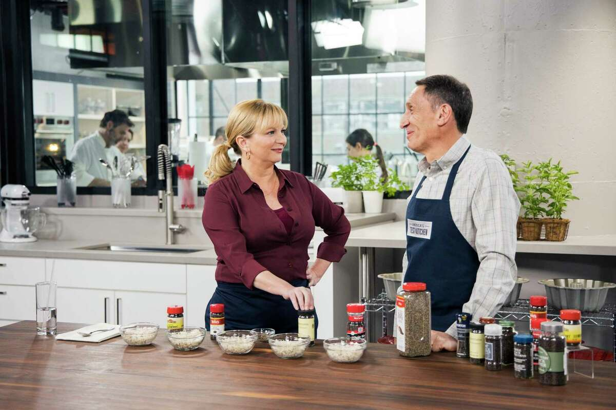 """This undated image released by America's Test Kitchen shows host Bridget Lancaster, left, and Chief Creative Officer Jack Bishop from the series """"America's Test Kitchen."""" The series is marking its 20th year on PBS and mixing up a new batch of younger viewers who are drawn to the cooking show online. (Kevin White/America's Test Kitchen via AP)"""