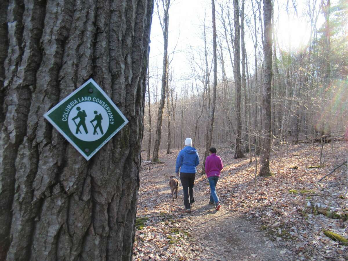 Outdoors writer Gillian Scott and her daughter walk at Hand Hollow Conservation Area in Columbia County. (Herb Terns / Times Union)