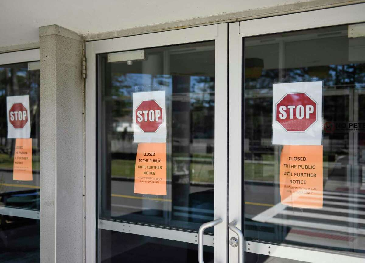 Closed signs are displayed at the entrance of the Eastern Greenwich Civic Center in Old Greenwich, Conn. Thursday, April 2, 2020. The state is looking at Greenwich Woods and the Eastern Greenwich Civic Center as facilities to separate long-term care residents diagnosed with coronavirus.