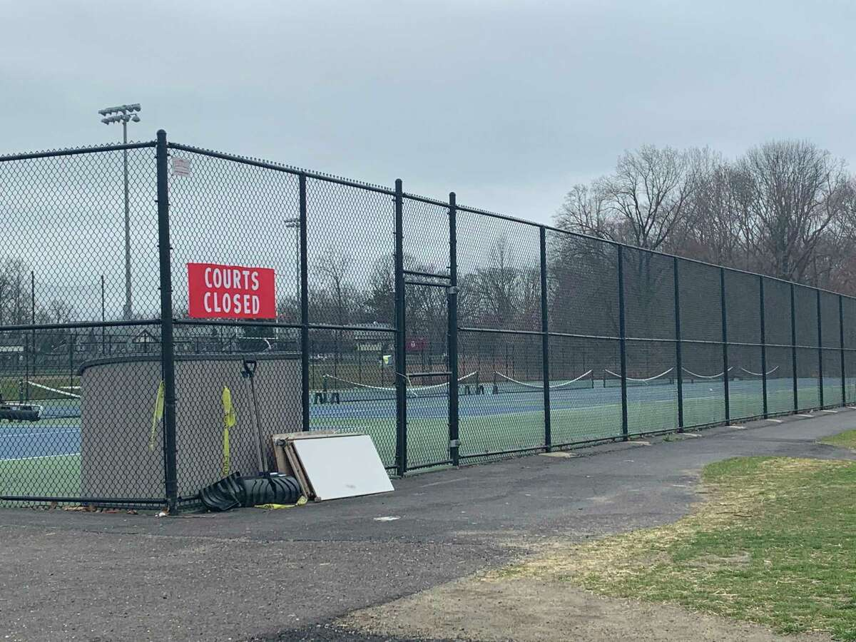 The tennis courts at New Canaan High School, which were filled around 2:30 p.m. Friday, March 27, are empty and locked behind a