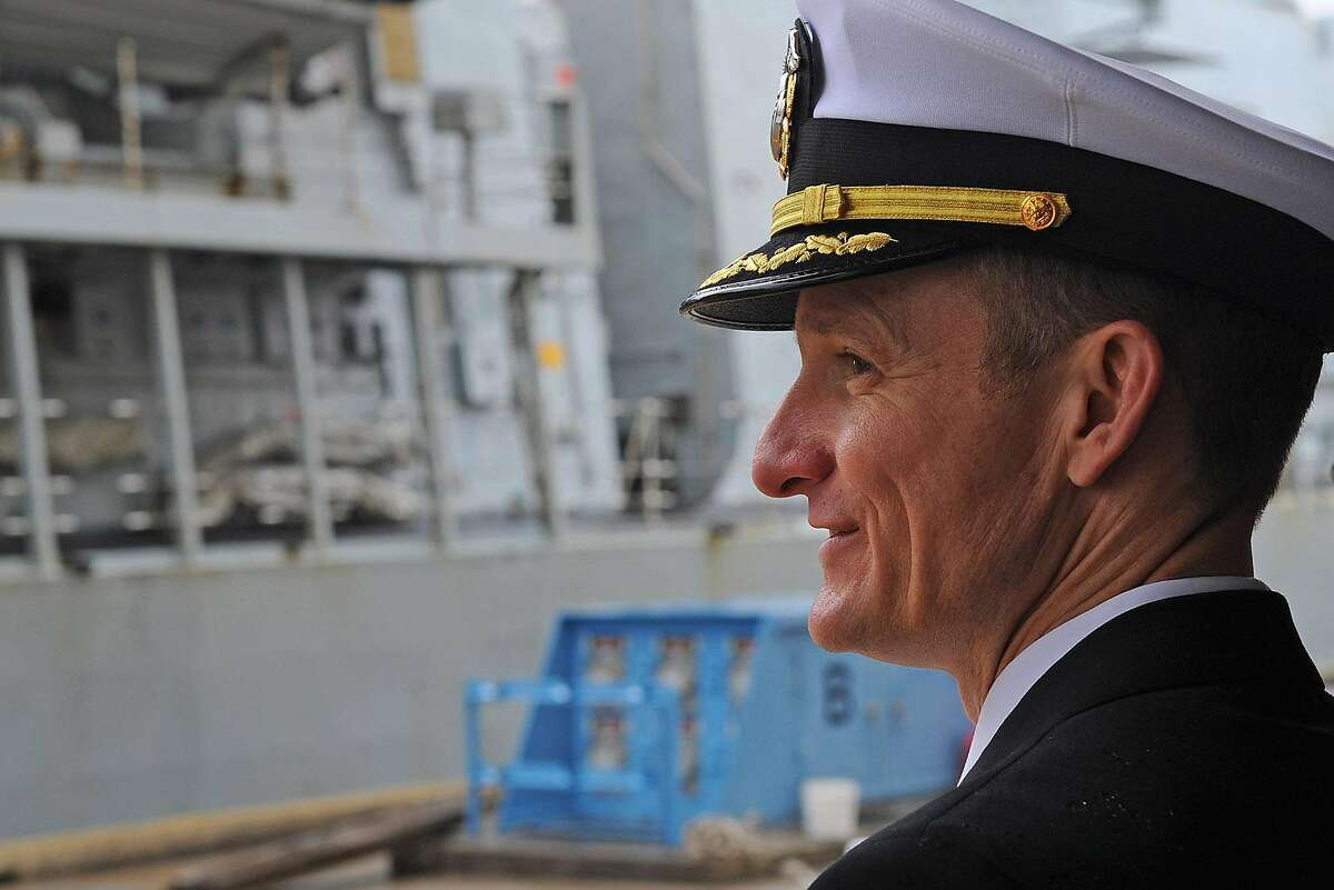 Commanding Officer of the U.S. 7th Fleet flagship USS Blue Ridge (LCC 19), Capt. Brett E. Crozier, watches as the British Royal Navy Type 23 frigate, HMS Sutherland moors pier side at Commander, Fleet Activities Yokosuka. USS Blue Ridge is sponsoring the HMS Sutherland during her port visit to Yokosuka, Japan. (U.S. Navy photo by Mass Communication Specialist 2rd Class Jordan KirkJohnson /RELEASED)