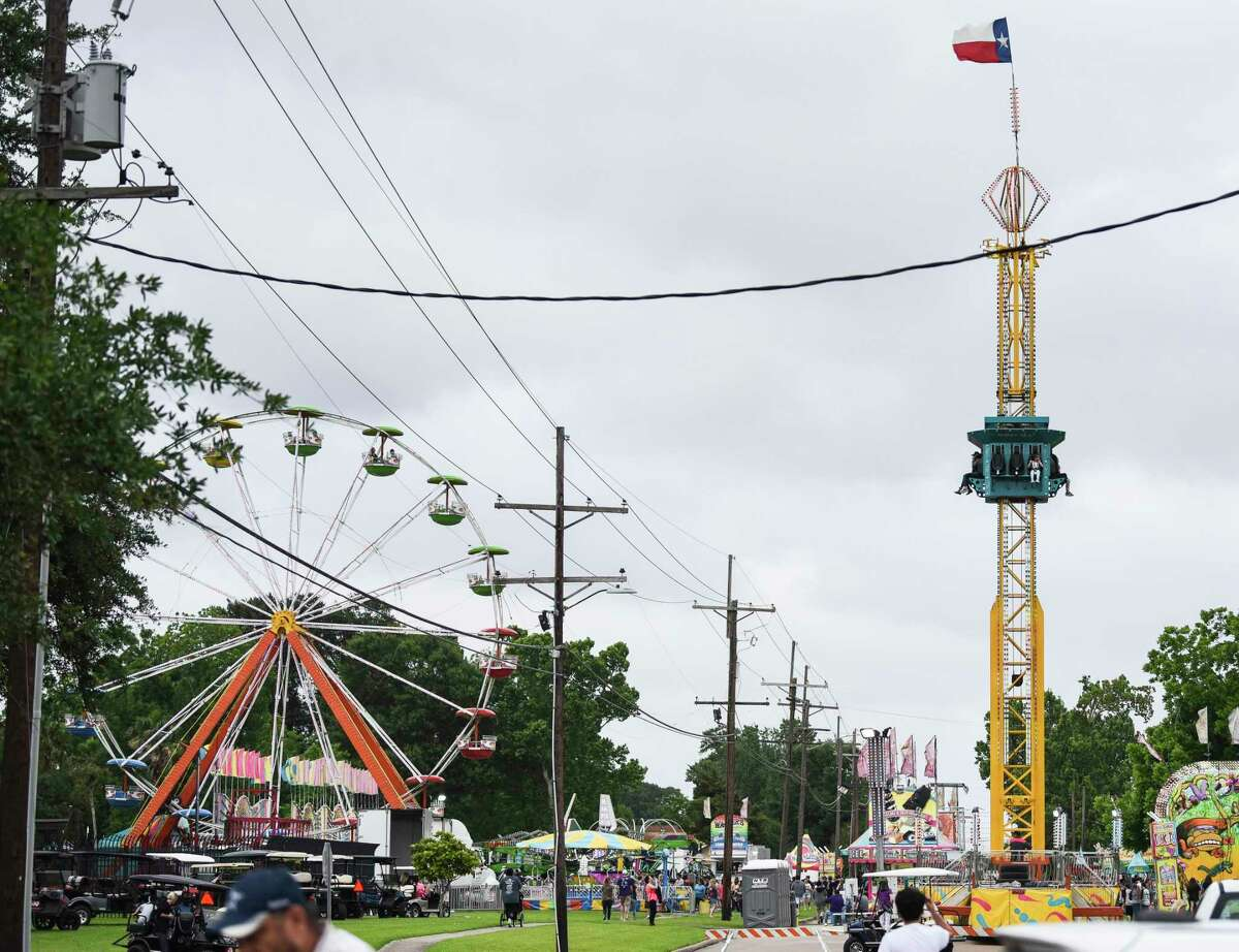 People enjoy one of the amusement rides at Port Neches RiverFest Wednesday afternoon. Photo taken on Wednesday, 05/01/19. Ryan Welch/The Enterprise