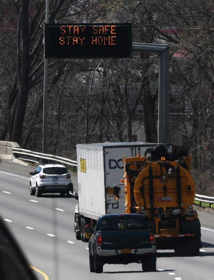 "A sign reading ""Stay safe, stay home"" flashes above the southbound lane of I-95 between Exit 5 and Exit 6 at the border of Greenwich and Stamford, Conn. Thursday, April 2, 2020. Photo: Tyler Sizemore / Hearst Connecticut Media / Greenwich Time"