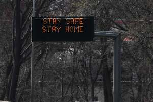 """A sign reading """"Stay safe, stay home"""" flashes above the southbound lane of I-95 between Exit 5 and Exit 6 at the border of Greenwich and Stamford, Conn. Thursday, April 2, 2020."""