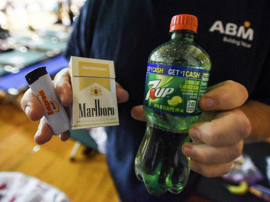Mark Best, from Vidor, shows the pack of cigarettes, lighter and soda that he was given by staff at the Spindletop Center after he and others were transported to the former Central High School after the school was turned into an emergency shelter for people affected by the flooding in Beaumont Friday. Photo taken on Friday, 09/20/19. Ryan Welch/The Enterprise Photo: Ryan Welch, Beaumont Enterprise / The Enterprise / © 2019 Beaumont Enterprise