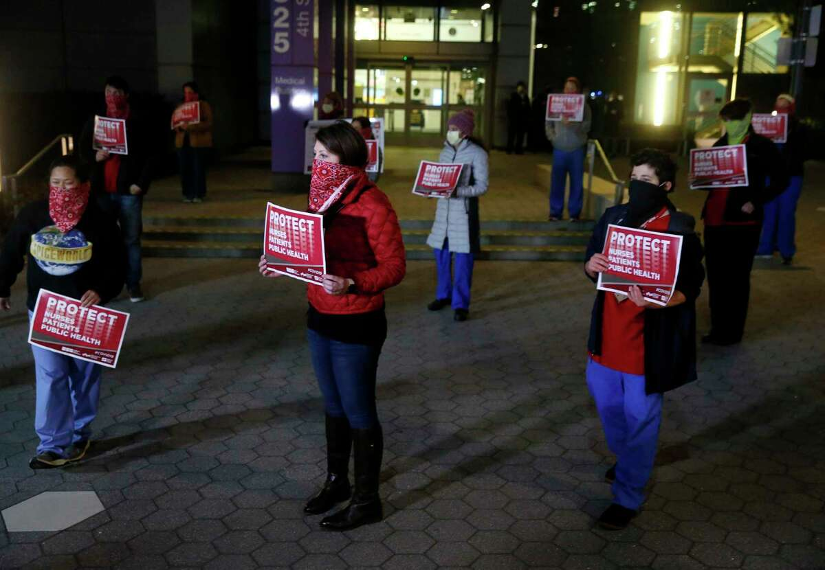 UCSF nurses hold a predawn rally to protest a lack of personal protective equipment.