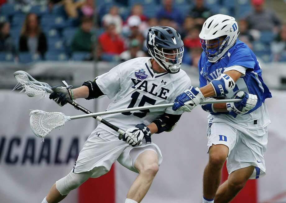 FILE - In this May 28, 2018, file photo, Yale's Jackson Morrill (15), left, is defended by Duke's Kevin McDonough during the first half of an NCAA college Division I championship final lacrosse game, in Foxborough, Mass. The Ivy League has decided not to allow its spring-sport athletes who had their seasons shortened by the coronavirus pandemic to have an additional year of eligibility, despite the NCAA granting that option earlier this week. The move, which was announced Thursday, April 2, 2020, was consistent for the Ivy League, which hasn't allowed athletes who received medical redshirts to play for a fifth year. Yale is an Ivy League school. (AP Photo/Michael Dwyer, File) Photo: Michael Dwyer / Associated Press / AP2018