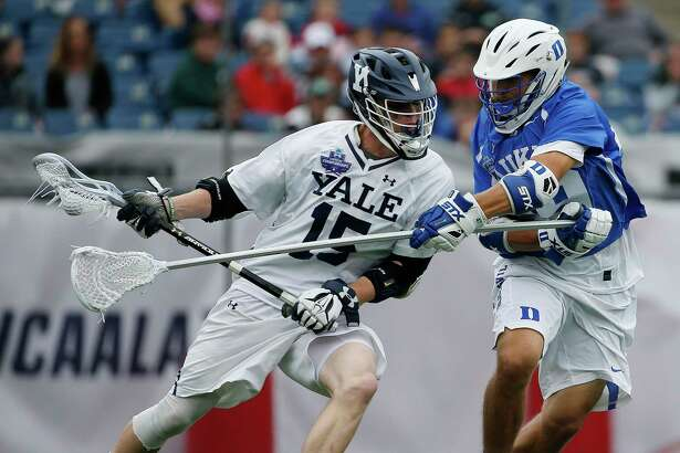 FILE - In this May 28, 2018, file photo, Yale's Jackson Morrill (15), left, is defended by Duke's Kevin McDonough during the first half of an NCAA college Division I championship final lacrosse game, in Foxborough, Mass. The Ivy League has decided not to allow its spring-sport athletes who had their seasons shortened by the coronavirus pandemic to have an additional year of eligibility, despite the NCAA granting that option earlier this week. The move, which was announced Thursday, April 2, 2020, was consistent for the Ivy League, which hasn't allowed athletes who received medical redshirts to play for a fifth year. Yale is an Ivy League school. (AP Photo/Michael Dwyer, File)