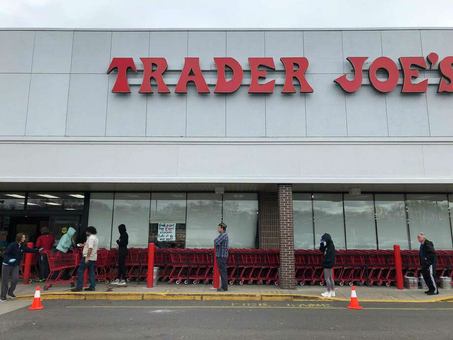 Customers waited in a long line to enter Trader Joe's in Orange, where the number of shoppers was being limited to prevent crowding inside. Photo: Liz Teitz / Hearst Connecticut Media
