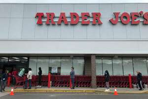 Customers waited in a long line to enter Trader Joe's in Orange, where the number of shoppers was being limited to prevent crowding inside.