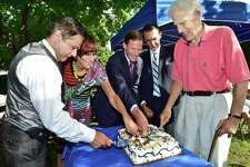 Ansonia Mayor David Cassetti, Congresswoman Rosa DeLauro, Senator Richard Blumenthal, Gregory Stamos and Ted Vartelas cut the cake for the residents of lower Naugatuck Valley as Ansonia commemorates the 60th anniversary of the Great Flood of 1955, Wednesday, August 19, 2015, on the bank of the Naugatuck River at Vartelas Park on Olson Drive in Ansonia. Two back-to-back hurricanes caused the Naugatuck River to swell, flooding the streets of Ansonia, destroying 85 buildings and many lost their lives. (Catherine Avalone/New Haven Register)