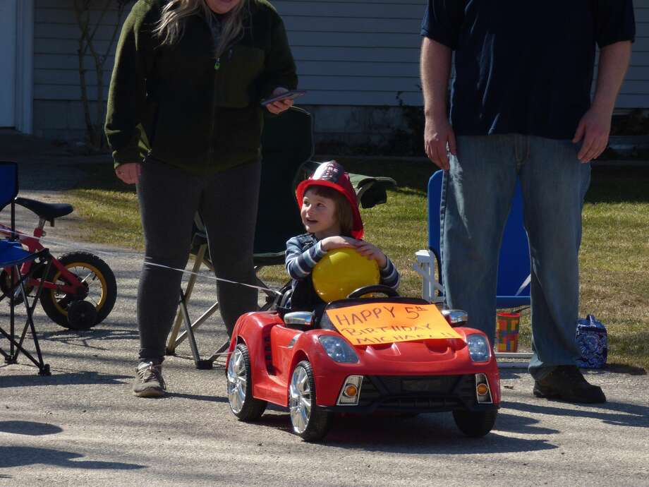 On Thursday, first responders and family members wished Michael, accompanied by his mother Sarah Baker, a happy 5th birthday with a parade. Photo: Scott Fraley/News Advocate