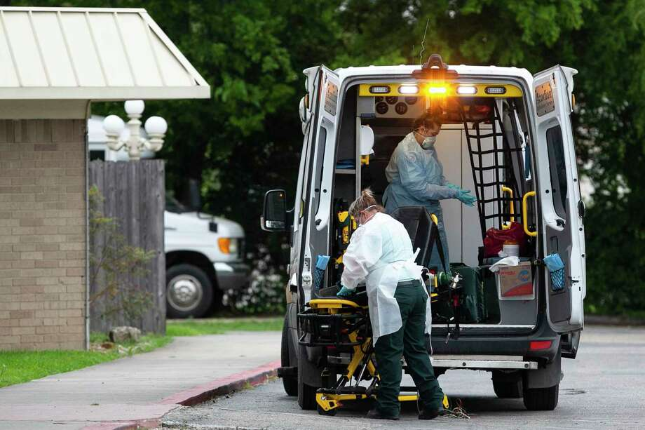 EMS personnel members disinfect equipment after responding to a call at Southeast Nursing & Rehabilitation Center in San Antonio, Texas, April 2, 2020. Photo: Josie Norris /Staff Photographer / **MANDATORY CREDIT FOR PHOTOG AND SAN ANTONIO EXPRESS-NEWS/NO SALES/MAGS OUT/TV